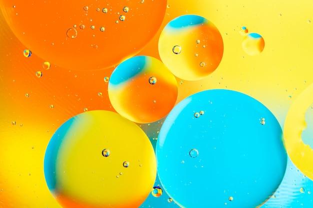 Pięknego koloru abstrakcjonistyczny tło od mieszanej wody i oleju.