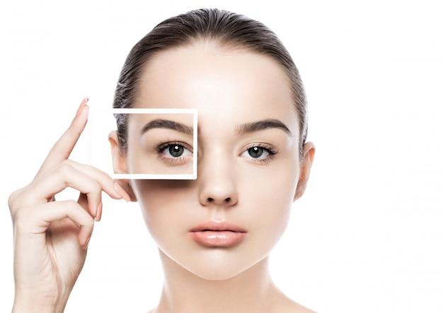 Pięknej kobiety dziewczyny makeup zdroju skóry opieki naturalny portret na białym tle. trzymając ramki na zdjęcia