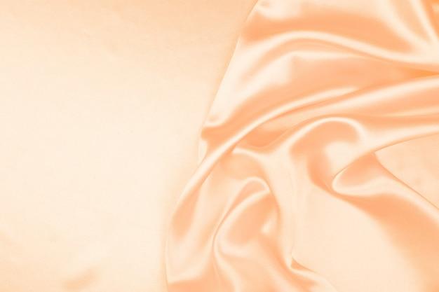 Pięknej kremowej jedwabniczej tekstury luksusowy atłas dla abstrakcjonistycznego tła, tkaniny tekstura