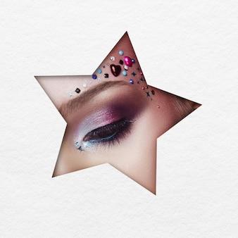 Piękno twarzy makijaż młodej dziewczyny w kształcie gwiazdy z białej księgi.