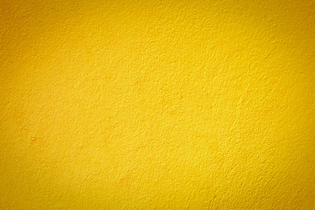 Piękny koloru żółtego cementu ściany tekstury tło.