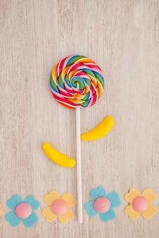 Piękny krajobraz tworzy się z lollipopem i cukierkami