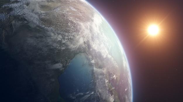Piękny realistyczny wschód słońca nad planetą ziemią widziany z kosmosu