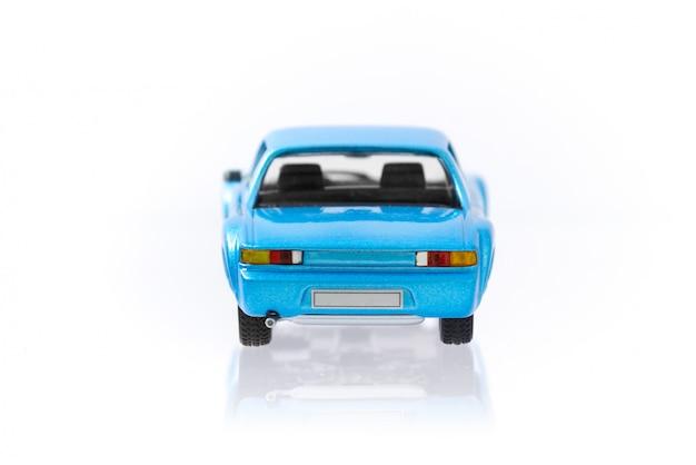 Piękny rocznik i retro wzorcowy błękitny samochód z tylnym bocznym profilem