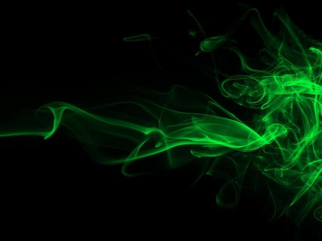Piękny zielony dym streszczenie na czarnym tła