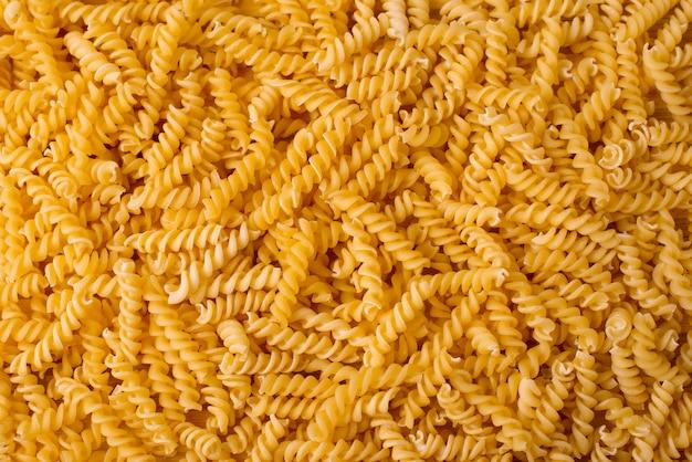 Piękny złoty włoski makaronu tło, życiorys jedzenie