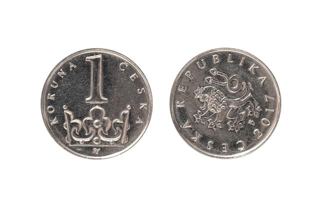 Pieniądze republiki czeskiej. 1 moneta korony czeskiej na białej odizolowanej powierzchni. widok z obu stron