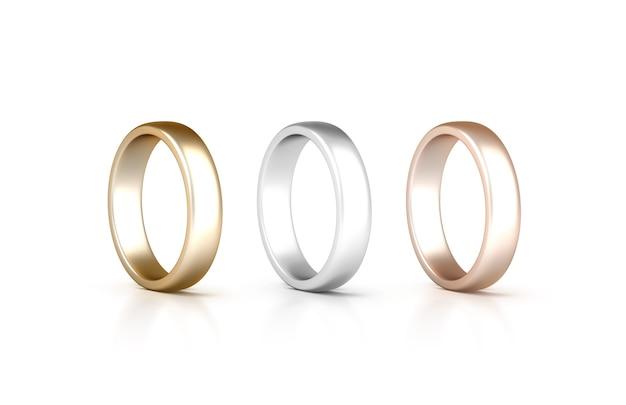 Pierścionki stoją na białym tle, biżuteria złota, srebra, różowego złota