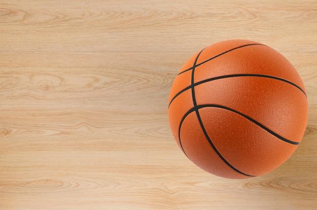 Piłka do koszykówki renderująca 3d na drewnianej podłodze