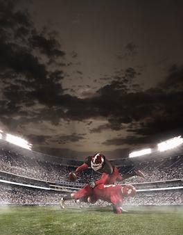 Piłkarze futbolu amerykańskiego w akcji na stadionie