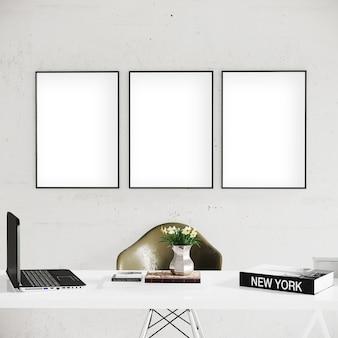 Pionowe ramy na białej ścianie z biurkiem i krzesłem