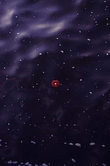 Pionowe ujęcie z góry pojedynczego czerwonego kwiatu unoszącego się na zbiorniku wodnym