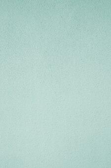 Pionowe, zielone, miętowe, betonowe detale ścian pomalowane na powierzchni