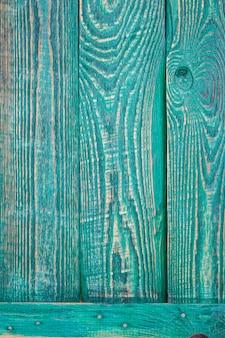Pionowo tło trzy zielonej drewnianej tekstury deski przymocowywającej horyzontalną deską.