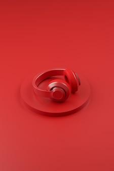 Pionowy obraz jasnych słuchawek na czerwonym tle monochromatyczne nowoczesne tło audio projekt d ...