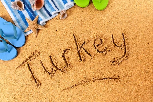 Pisanie na plaży w turcji
