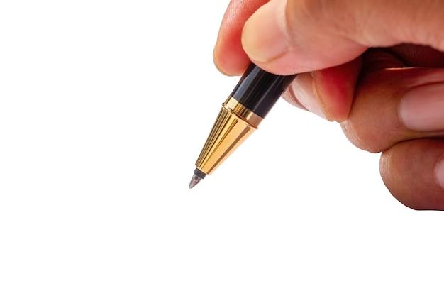 Pisanie złotym długopisem, w płytkiej ostrości, na białym tle