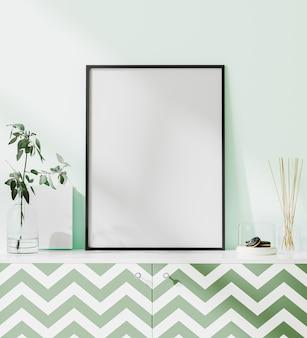 Plakat wewnętrzny makieta z pionową pustą ramą na biurku ze ścianą w kolorze mięty, renderowanie 3d