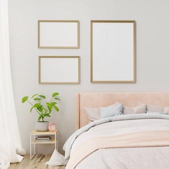 Plakat wewnętrzny makieta z ramkami na ścianie we wnętrzu sypialni w domu.