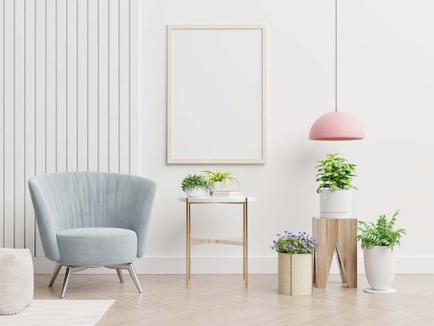 Plakatowa makieta na pustej białej ścianie we wnętrzu salonu z niebieskim aksamitnym fotelem