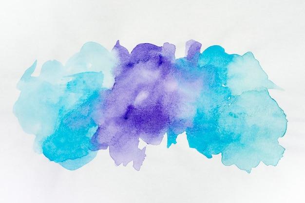 Plamy akwarela niebieskie i fioletowe plamy farby