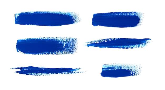 Plamy farby olejnej na białym tle. kolekcja abstrakcyjnych pociągnięć pędzlem akrylowym.