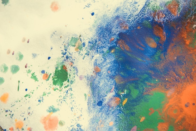 Plamy z farby wielobarwnej, zacieki, odpryski, mieszanie. abstrakcyjne tło