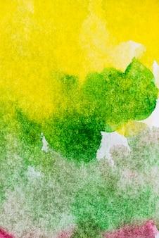 Plamy z żółtym i zielonym tle akwarela