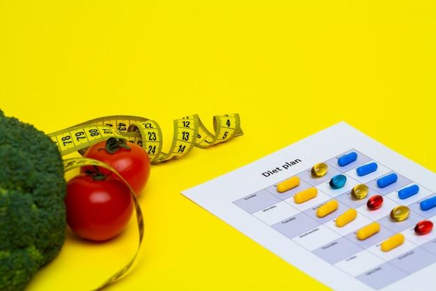 Plan diety dla tabletek odchudzających i świeżych warzyw na żółto.