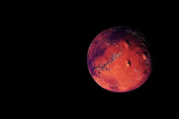 Planeta mars, na ciemnym tle. elementy tego obrazu dostarczyła nasa. zdjęcie wysokiej jakości