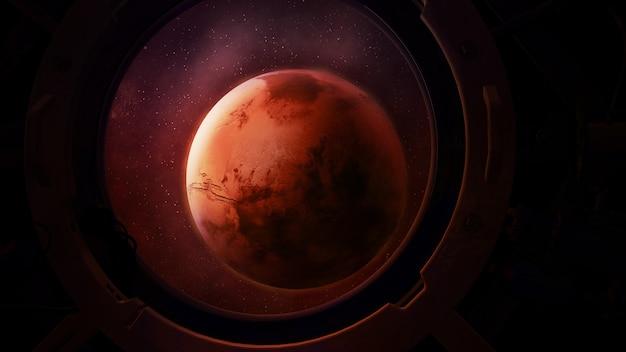 Planeta mars z okrągłego iluminatora statku kosmicznego