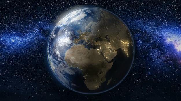 Planeta ziemia w czarno-niebieskim wszechświecie gwiazdy