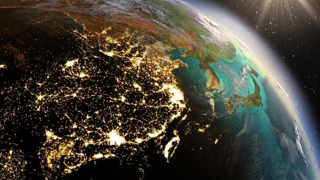 Planeta ziemia w nocy i wschodzie słońca
