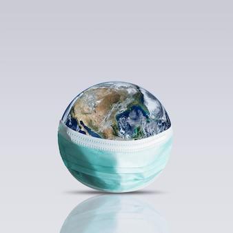 Planeta ziemia z maską ochronną. światowa koncepcja medyczna.