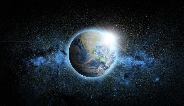 Planeta ziemia z wschodem słońca w przestrzeni kosmicznej