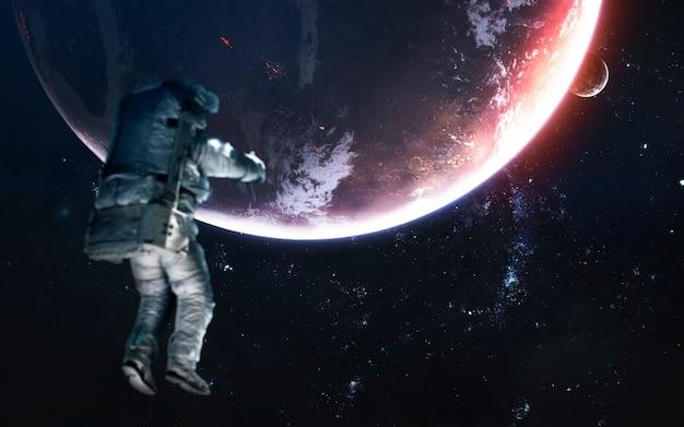 Planety kosmosu, niesamowita tapeta science fiction, astronauta na spacerze kosmicznym. elementy tego zdjęcia dostarczone przez nasa