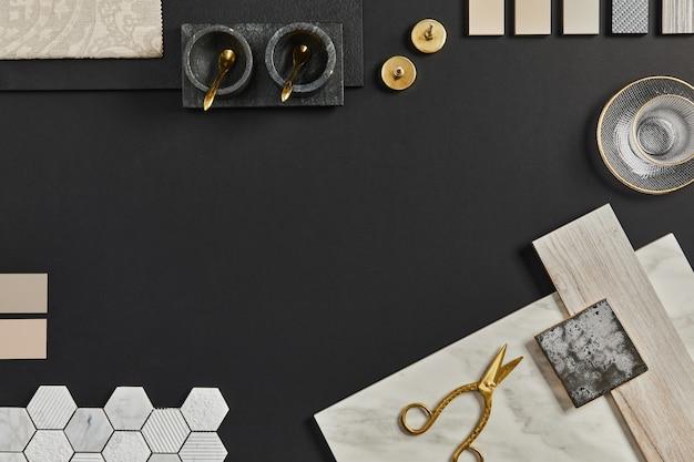 Płaska kompozycja kreatywnego, czarnego moodboardu architekta z próbkami materiałów budowlanych, tekstylnych i naturalnych oraz osobistych akcesoriów. widok z góry, czarny backgroung, szablon.