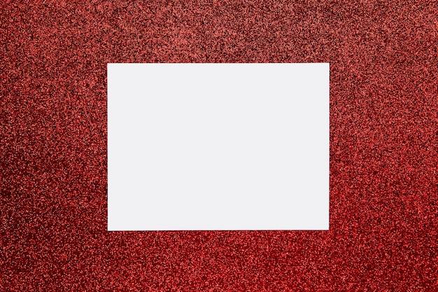 Płaski układ karty, ramka z miejscem na tekst na jasnoczerwonym blasku brokatem
