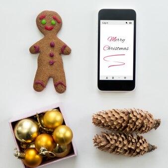 Płaski widok telefonu komórkowego wśród cute dekoracji bożego narodzenia
