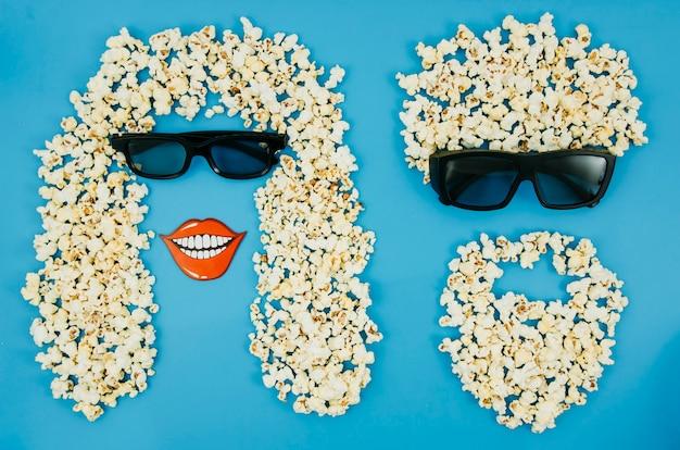 Płaskie ukształtowanie popcornu i okularów 3d dla koncepcji kina