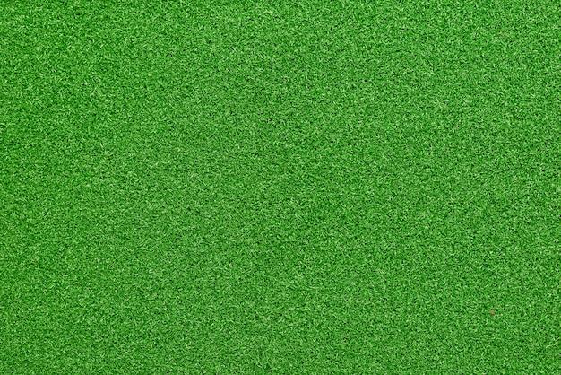 Płaskie zielone tło tekstury sztucznej trawy