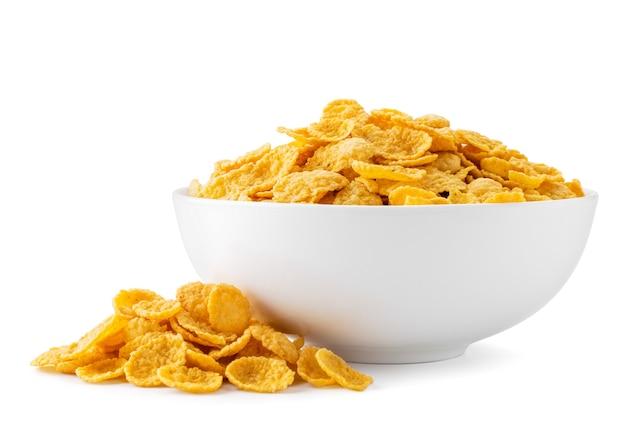 Płatki kukurydziane w talerzu i rozproszone odosobniony
