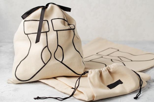 Płócienna torba ze sznurkiem, makieta małego eko woreczka z naturalnej bawełnianej tkaniny