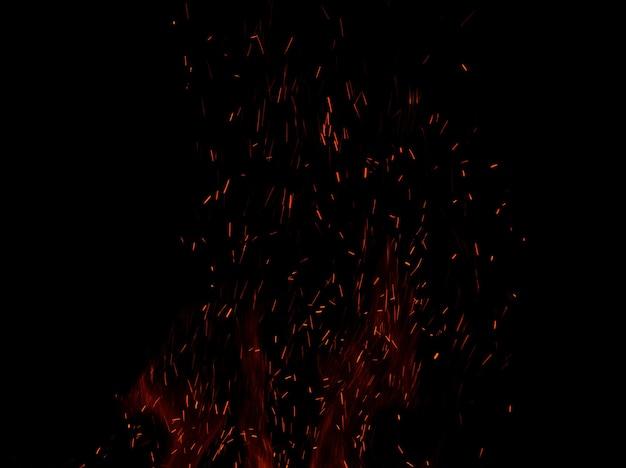 Płomienie ognia z iskrami na czarnym tle