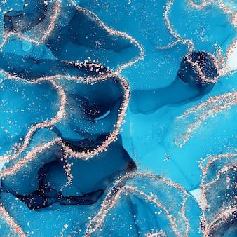 Płyn alkoholowy z niebieskim tuszem ze złotymi iskierkami