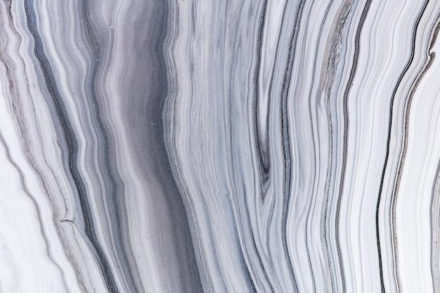 Płynna tekstura sztuki. tło z abstrakcyjnym efektem mieszania farby. płynna grafika akrylowa z przepływami i rozpryskami.