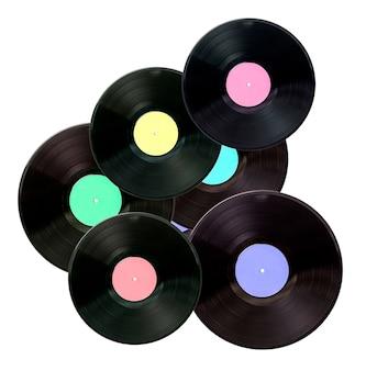 Płyta winylowa z kolorową etykietą samodzielnie na białym tle.