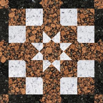 Płytki z geometrycznym wzorem, wykonane z naturalnego granitu i marmuru.