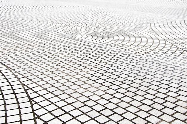 Płyty chodnikowe, wzorzyste płytki chodnikowe, cementowe ceglane podłogi tło
