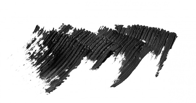 Pociągnięcia pędzlem czarny tusz do rzęs na białym tle